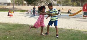 Kids playing tag.